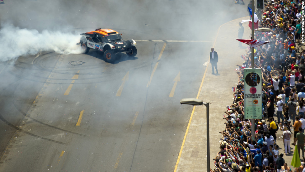 France's Guerlain Chicherit shows off during the 2013 Dakar Rally podium ceremony on January 20.