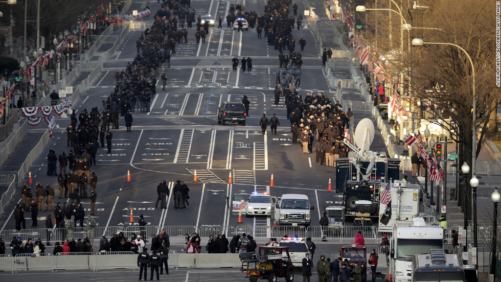 Police stand guard along the inauguration parade route Monday.