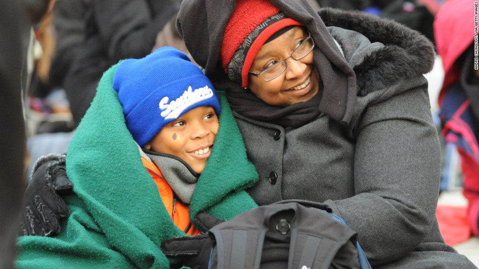 Bonita Volcy and nephew Cullan King, 10, of Texas try to keep warm on the National Mall in Washington on Monday.