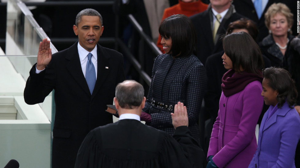 Obama is sworn in by Chief Justice John Roberts as first lady Michelle Obama and daughters Malia and Sasha watch on Monday, January 21.