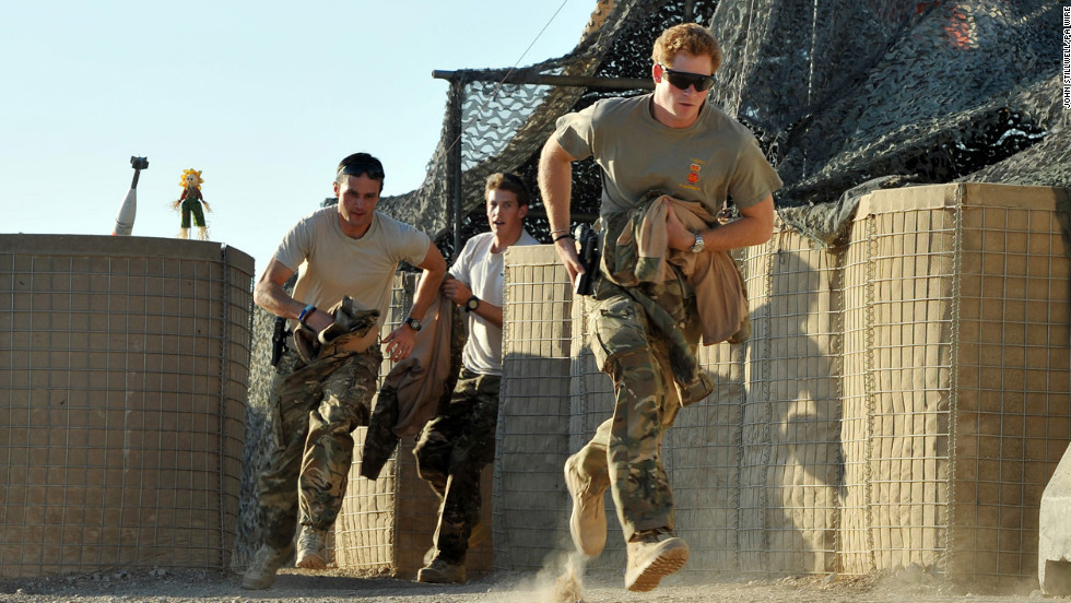 Harry runs from the VHR (very high readiness) tent to scramble his Apache helicopter with other pilots during a 12-hour shift at Camp Bastion on November 30, 2012.