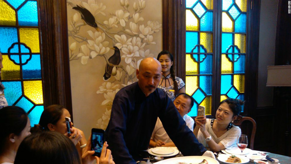 Dressed as Chiang Kai-shek,  Xu Jinshui showcases food popular during the Republican period at a restaurant in Nanjing.
