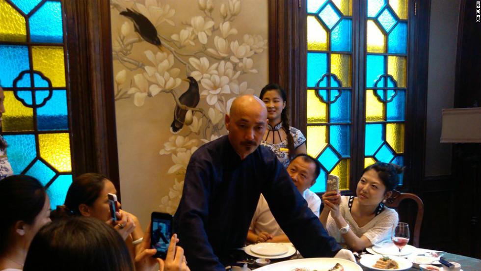 Dressed as Chiang Kai-shek,  Xu Jinshui showcases food popular during the Republican period at a restaurant in Nanjing.