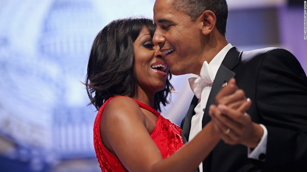 The Obamas sing together as they dance.