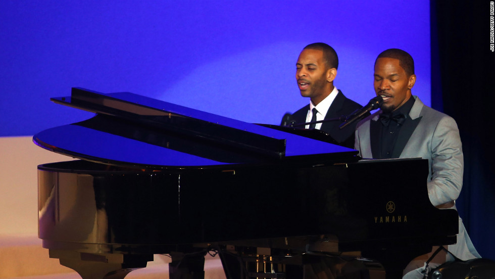 "Jamie Foxx, right, sings Ray Charles' ""I Can't Stop Loving You"" during the first dance of Vice President Joe Biden and Jill Biden at the Commander-in-Chief's Ball. Foxx earned an Oscar playing the late Ray Charles in the 2004 film ""Ray."""