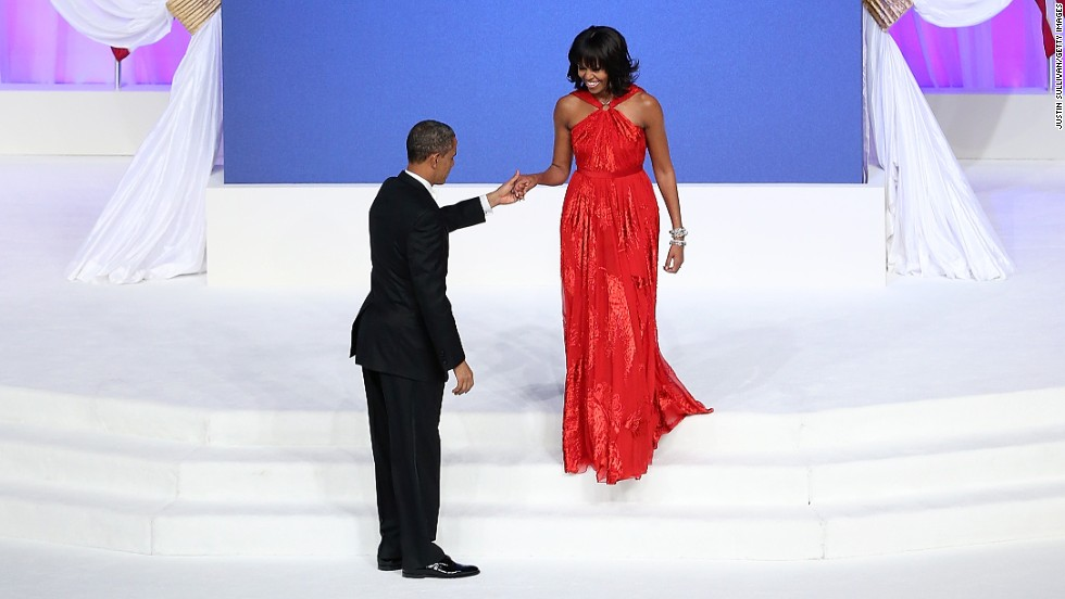 U.S. President Barack Obama prepares to dance with first lady Michelle Obama at the Commander-in-Chief Ball on Monday,January 21, 2013 in Washington. Obama was sworn in for his second term as president during a public Inauguration earlier in the day.
