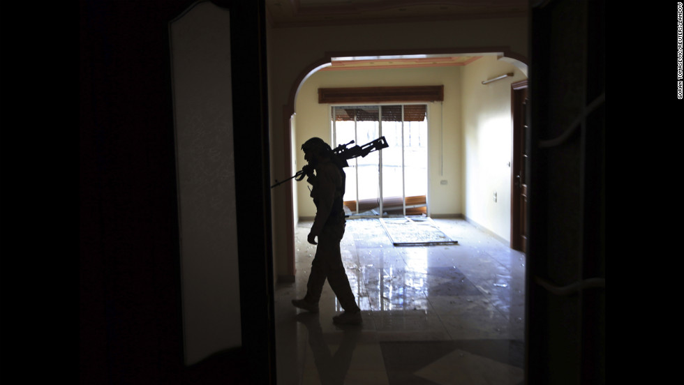 A fighter walks inside a house during heavy fighting in Mieha suburb of Damascus on January 22.