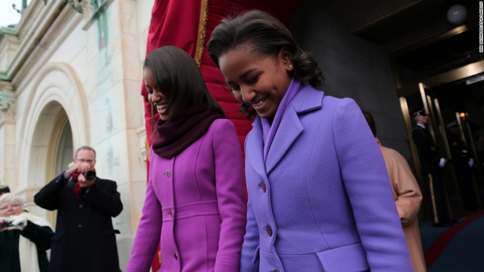 Malia and Sasha arrive for the presidential Inauguration on the West Front of the U.S. Capitol.