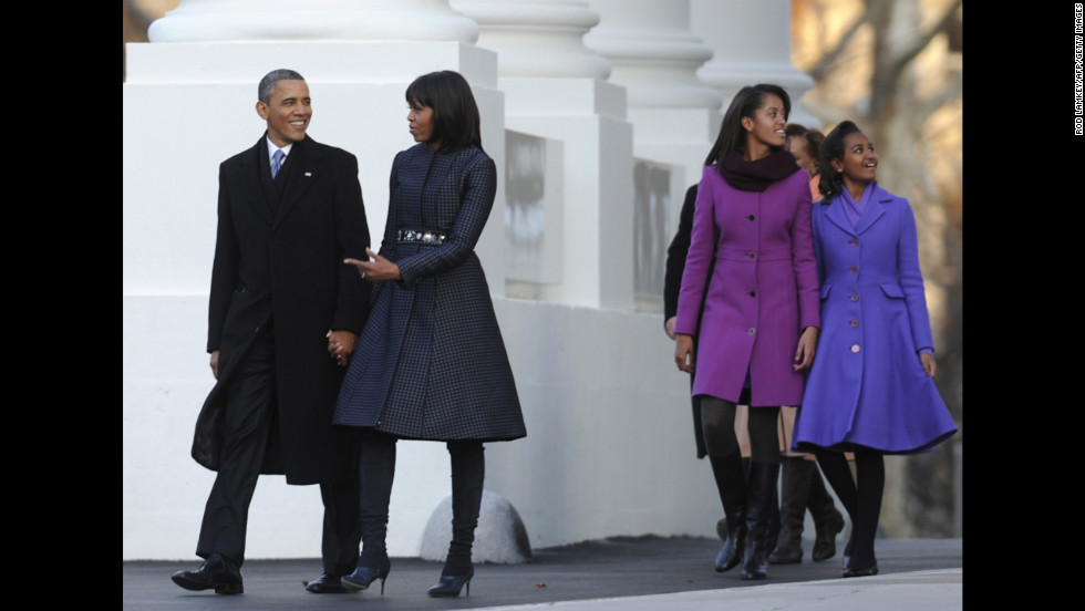 Sasha and Malia walk with their parents to the reviewing stand on Pennsylvania Avenue to watch the Parade during the 57th Presidential Inauguration.