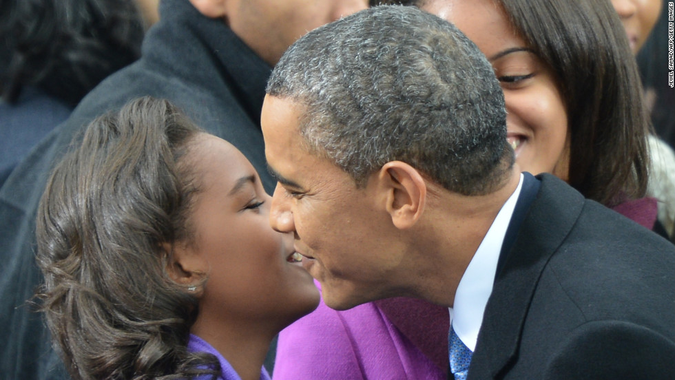 Sasha greets her father before the Inauguration ceremony.