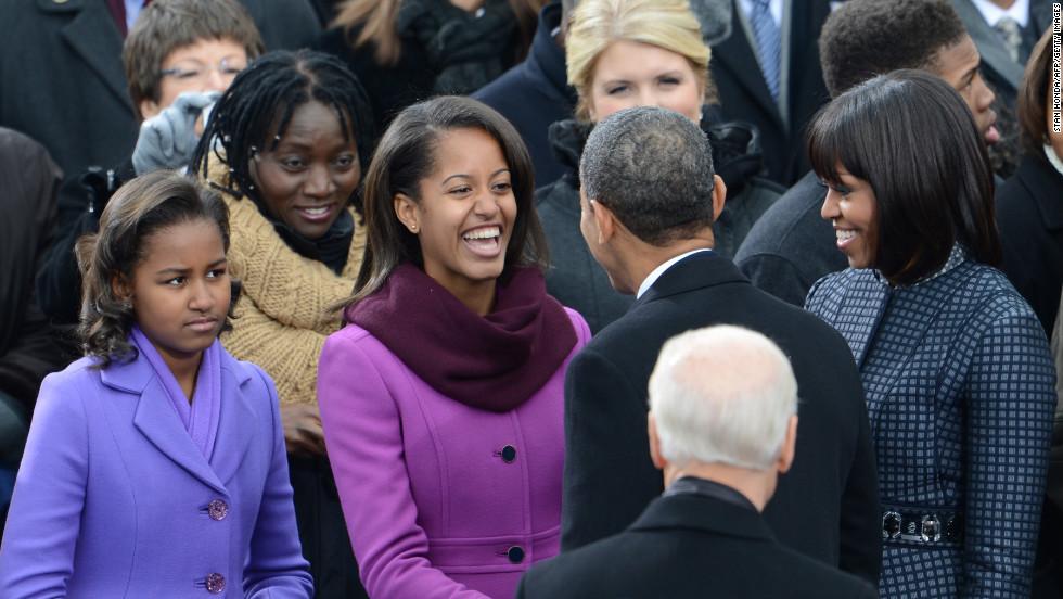 Malia greets her father President Barack Obama.