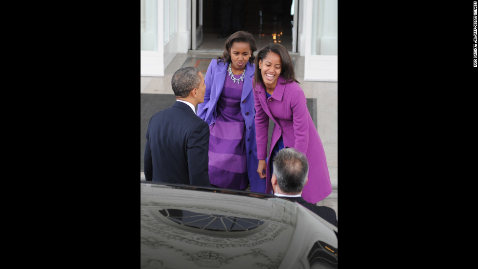 President Obama and his daughters return to the White House from St. John's Episcopal Church in Washington, after prayer services.