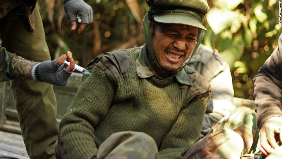 An injured Kachin Independence Army soldier receives an injection from a medic on Hka Ya mountain in Kachin province on January 20, 2013.