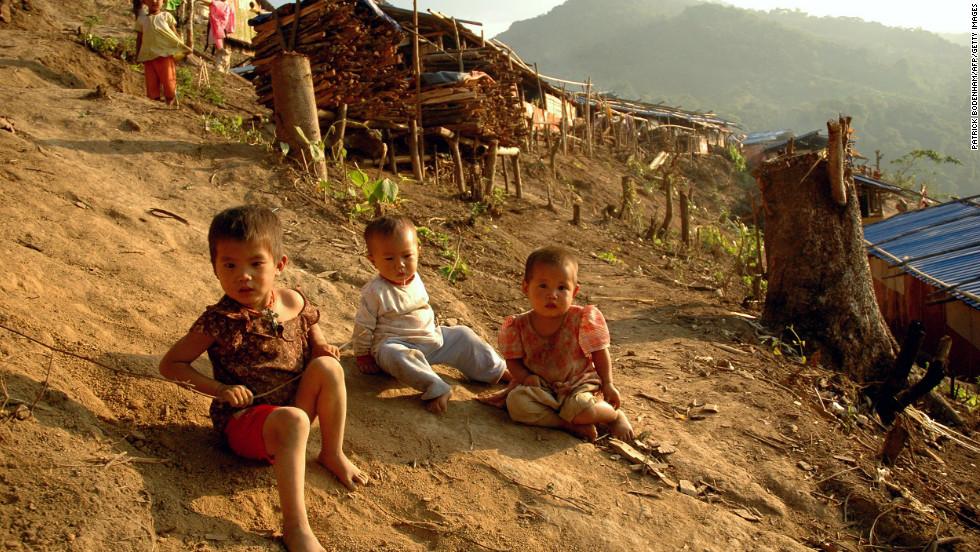 Kachin children play outside wooden shacks at the N-Hkawng Pa Internally Displaced People's (IDP) camp outside Mai Ja Yang, May 2012.