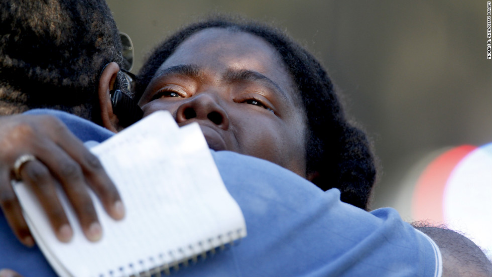 Lone Star College freshman Sheketa Taylor embraces her father, Judson Gimblin, after a shooting on the suburban Houston campus Tuesday, January 22. Three people were left wounded on Lone Star's North Harris campus, authorities said, after an apparent argument between two men.