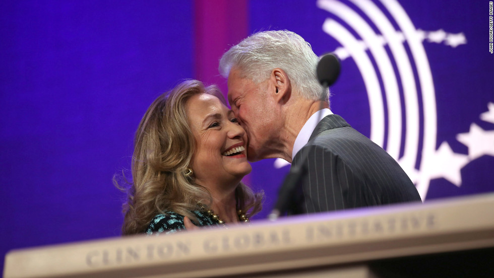 Bill Clinton kisses his wife after introducing her at the Clinton Global Initiative annual meeting on September 24, 2012, in New York City.