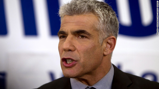 Yair Lapid, chairman of Yesh Atid party, speaks to supporters early Wednesday in Tel Aviv, Israel.