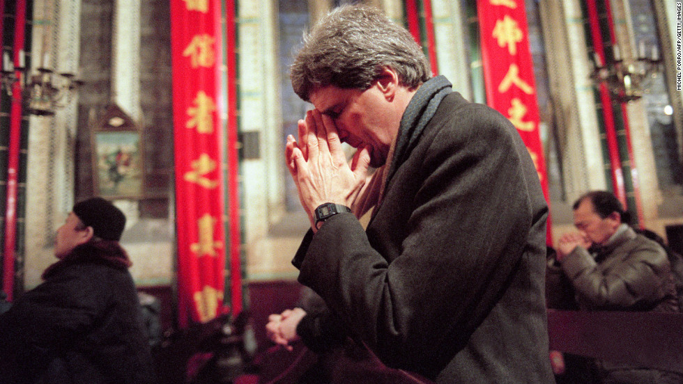 Kerry prays during an early Mass on January 11, 1994, at the Bei Hai Cathedral in Beijing. He paid his respects to Tip O'Neill, former speaker of the House of Representatives, whose funeral would be held later in the day in Washington.