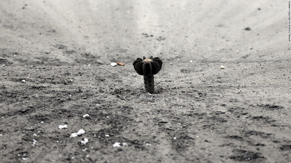 An unexploded mortar shell fired by the Syrian Army sits lodged in the ground in Damascus on January 25.