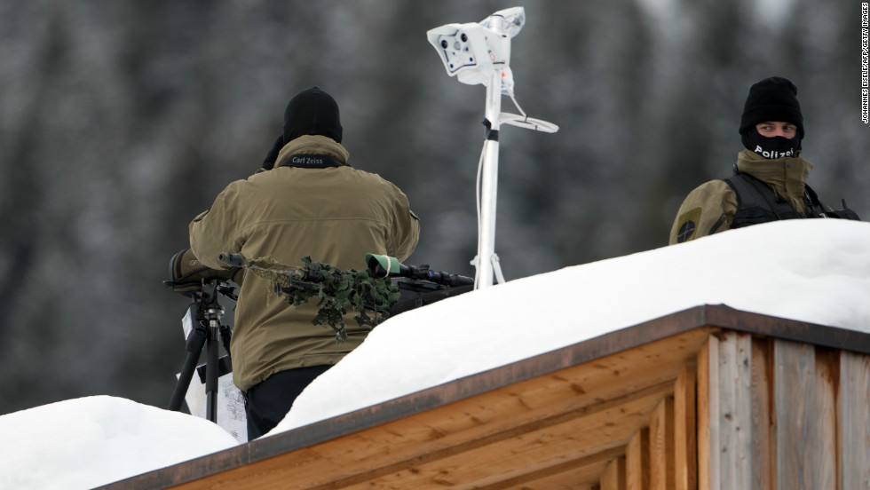 Policemen stand guard on the roof of the congress center in Davos.