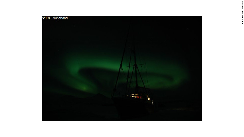 The swirling northern lights in the skies above <em>Le Vagabond</em> in Spitsbergen, Norway.