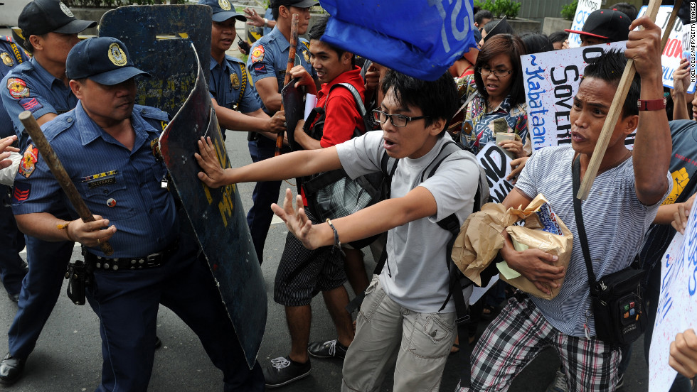 Student activists scuffle with police in front of the U.S. Embassy in Manila during a January 19 protest condemning the minesweeper's grounding.
