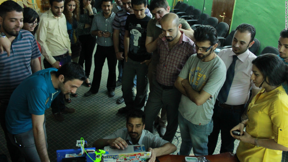 "Bilal Ghalib, an Iraqi-American advocate for hackerspaces in the Middle East, told CNN he wants to see ""A thousand hackerspaces from Turkey to Morocco."" Here, he demonstrates new equipment to members of Fikra Space, Baghdad's first hackerspace."