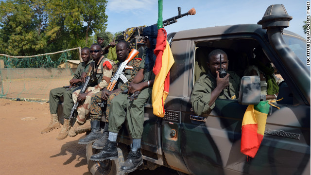 Malian soldiers patrol in a street in Diabaly on Wednesday.