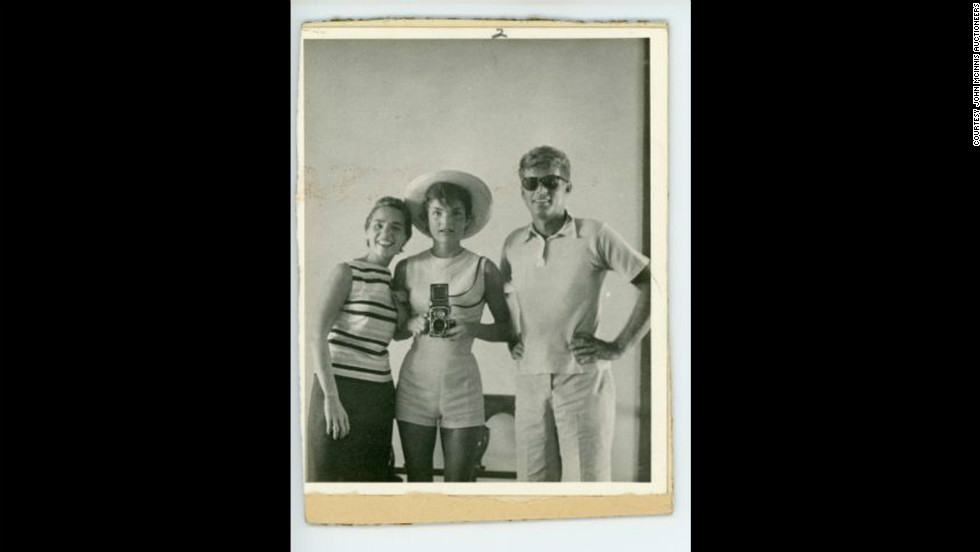 Photograph of Ethel, Jackie and John F. Kennedy taken by Jackie looking into a mirror, circa 1962.