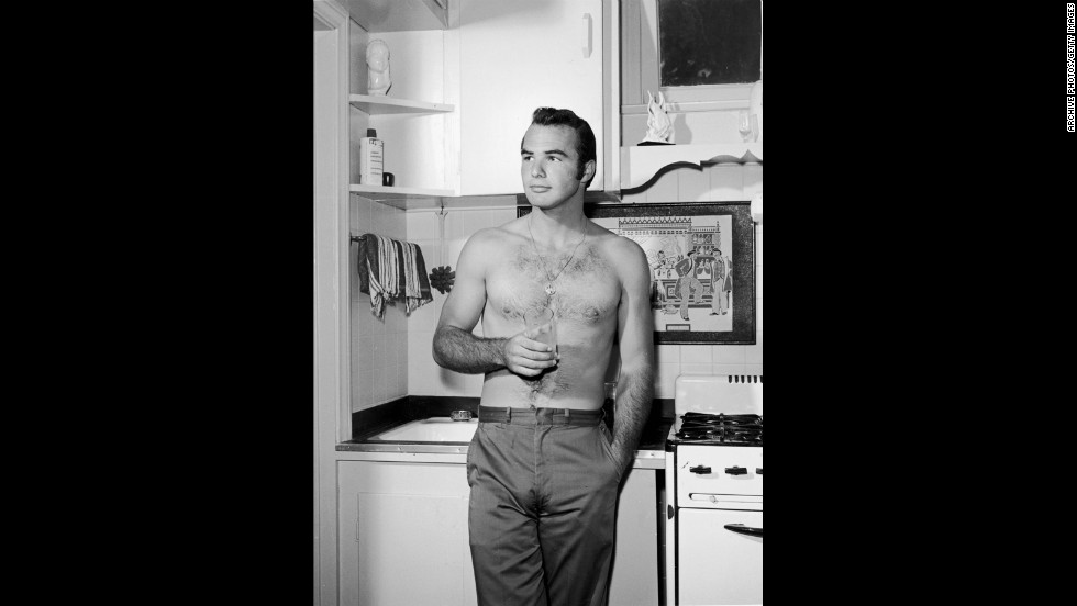 Reynolds stands bare-chested on a kitchen set in 1960.