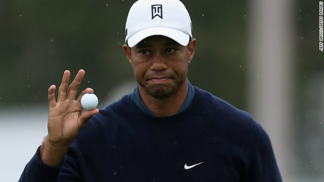 Tiger Woods signals to the gallery after making an eagle putt on the 18th hole at Torrey Pines.
