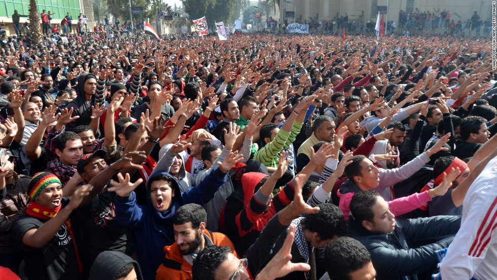 Egyptian fans of Al-Ahly football club celebrate outside the club's headquarters in Cairo on January 26.
