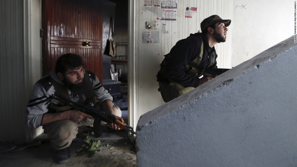 Fighters from the Free Syrian Army's Tahrir al Sham brigade take positions during heavy fighting in Damascus on Saturday, January 26.