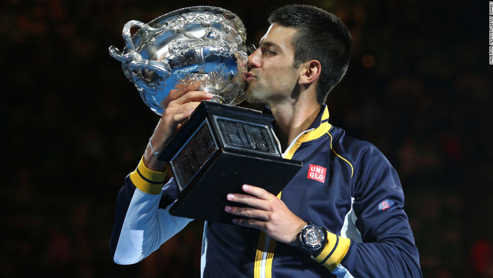 Djokovic holds the Norman Brookes Challenge Cup on January 27.