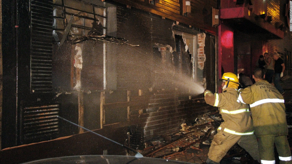 Firefighters work to extinguish the blaze that broke early Sunday.