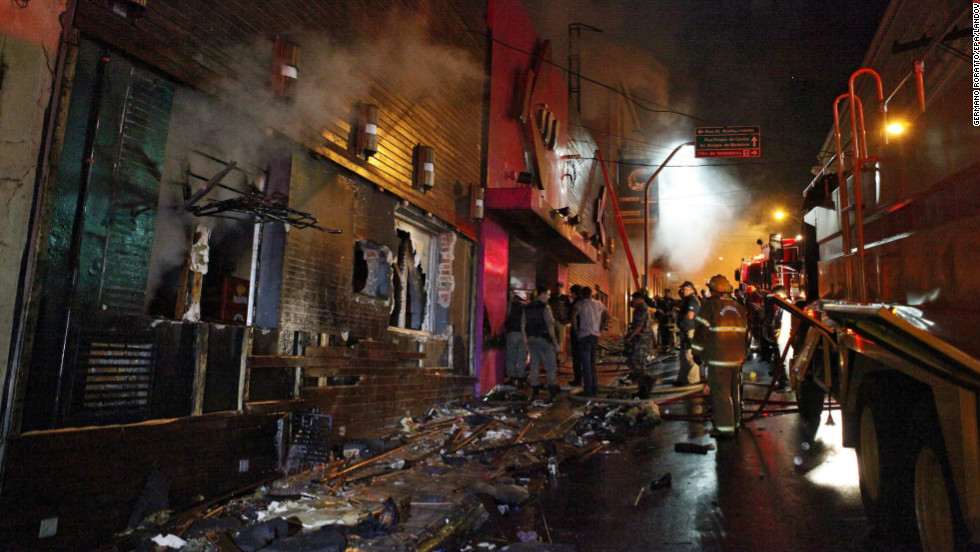 Emergency personnel gather outside the burned-out Kiss nightclub in Santa Maria, Brazil. The nightclub is popular with young people, drawing between 2,000 and 3,000 people a night on the weekends.