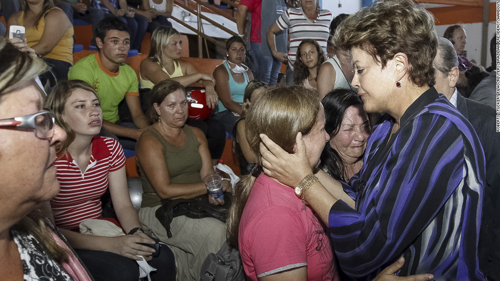 Brazilian President Dilma Rousseff, right, consoles relatives of victims of the fire.