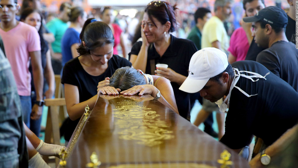 Relatives of a victim of a fire that broke out at the Kiss nightclub weep during the funeral in Santa Maria, Brazil, on Sunday, January 27.