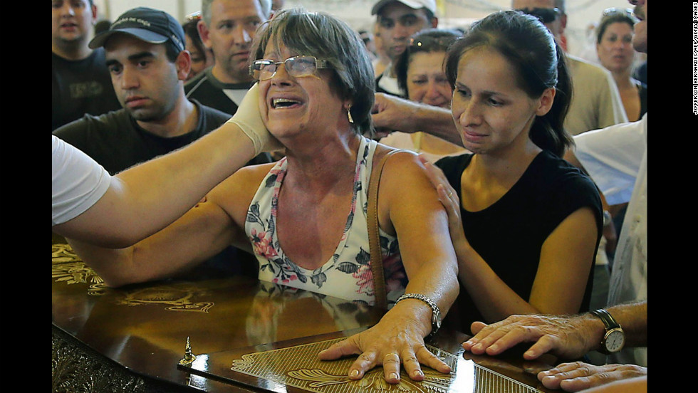Relatives of victims weep during a funeral in Santa Maria on January 27.