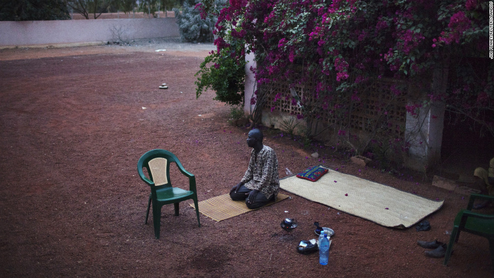 A man prays in the recently liberated town of Douentza on January 28.
