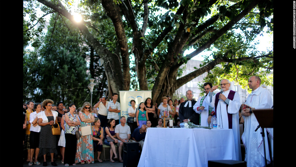 A priest celebrates Mass in a public square in the center of Santa Maria on January 28.