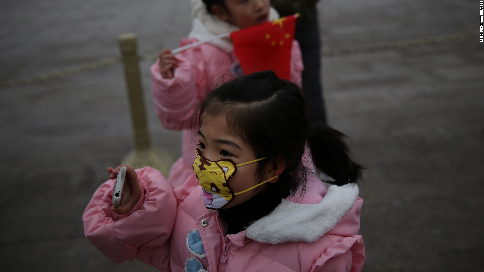 A little girl wears a cartoon mask on January 29 at Tiananmen Square to protect herself from pollution.