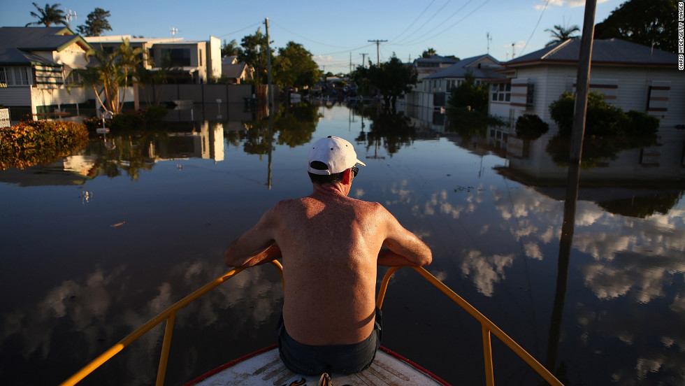 A man checks out flood damage to houses in Bundaberg, Australia, on Tuesday, January 29