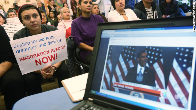 Undocumented immigrant Katherine Taberes holds a sign during the watch party for President Obama's speech.