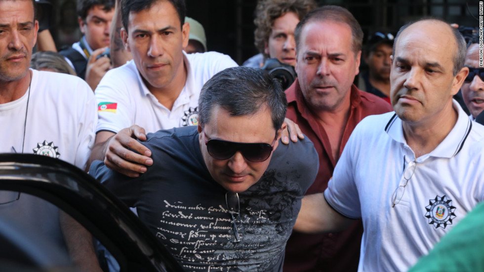 Mauro Hoffman, co-owner of the Kiss nightclub, is taken into custody by police in Santa Maria, Brazil, on Monday, January 28.
