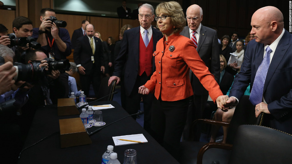 Former Rep. Gabrielle Giffords (D-AZ) takes her seat at a Senate Judiciary Committee hearing about gun violence. Giffords was wounded in a January, 2011 shooting. Her husband, retired NASA astronaut and Navy Capt. Mark Kelly holds her hand.