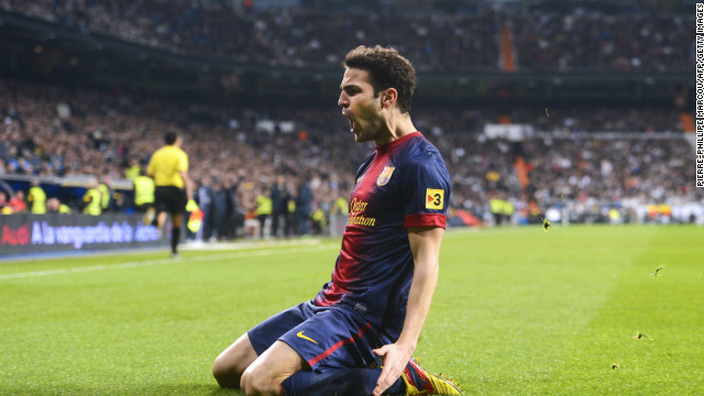 Barcelona's Cesc Fabregas celebrates after giving his side the lead at the Santiago Bernabeu.