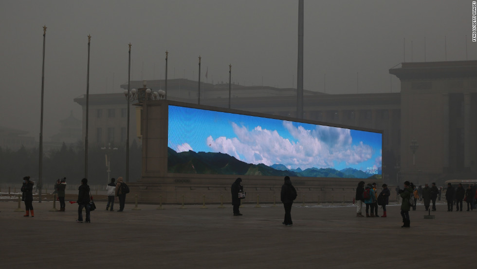 A stark comparison between the clear blue sky image on this LED screen in Tian'anmen Square, January 2013, against the grey smog reality. Beijing saw record levels of air pollution at the turn of the new year.