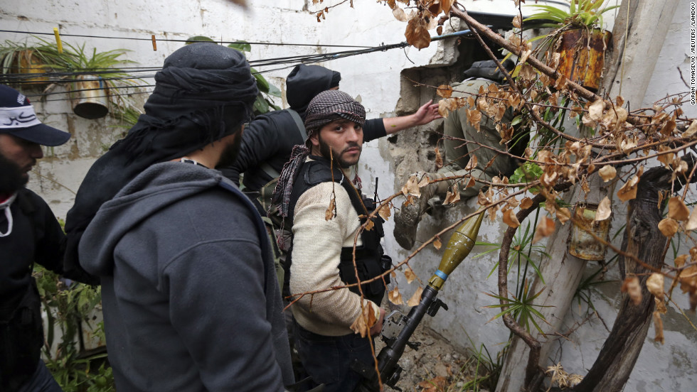 Rebel fighters prepare to attack a Syrian Army checkpoint in Ain Tarma.