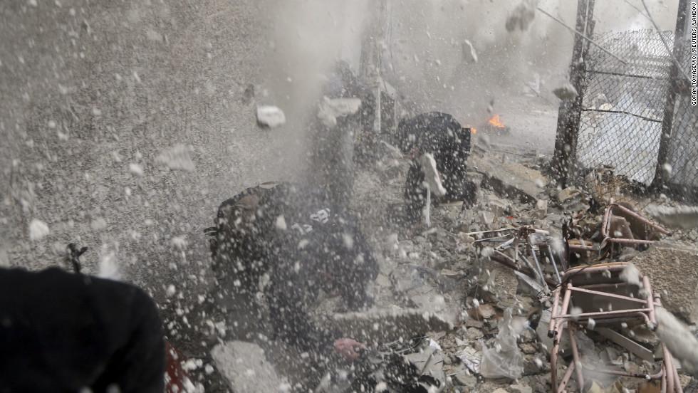 Fighters run through the debris.